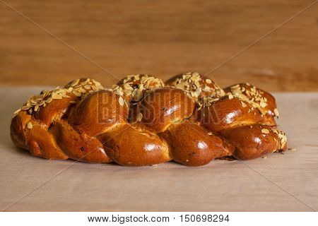 detail of christmas cake sprinkled with almonds on wooden background Typical Czech Christmas cakes