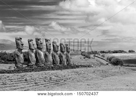 Black and white photo of moai statues at Ahu Akivi on Easter Island in Chile