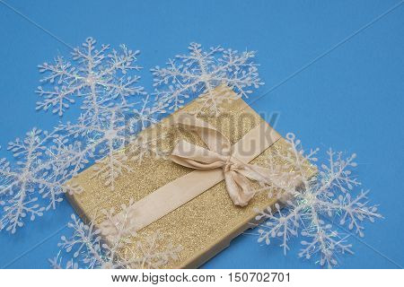 Gold box with wintery snowflake Christmas decoration