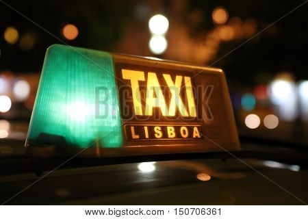 Taxi Sign in Lisbon, Portugal, by night