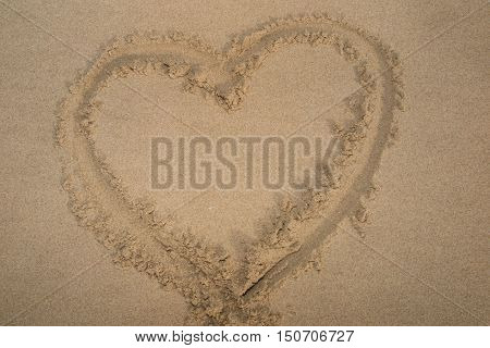 a Heart drawn on sand. Horizontal composition.