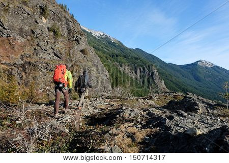 Intrepid Climbers Hike Among Cliffs.  Snoqualmie Pass, Cascade Mountains, Washington