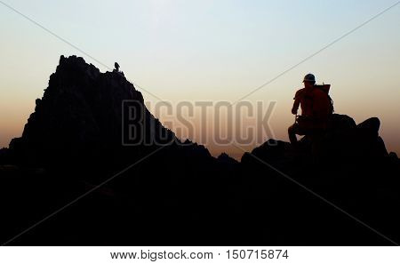 Climber Looking Towards Alpine Skyline. The Alpine Lakes Wilderness, Washington