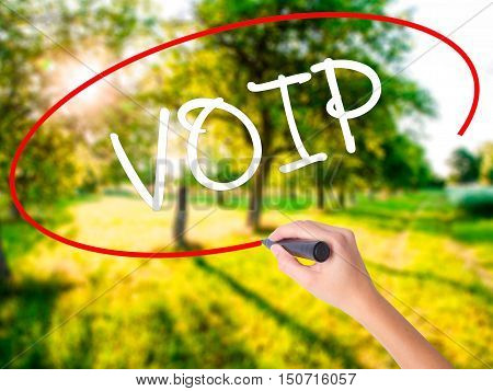 Woman Hand Writing Voip With A Marker Over Transparent Board
