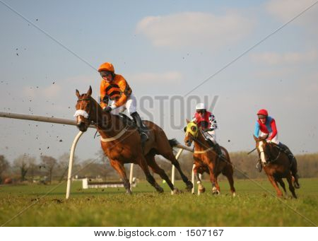 horses racing at speed and cornering round bend poster