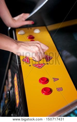 Young Woman Playing Arcade