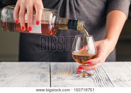 Alcoholism Start. Female Take Wine Glass On Dark Toned Table
