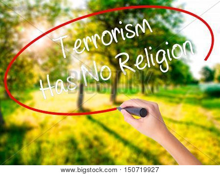 Woman Hand Writing Terrorism Has No Religion  With A Marker Over Transparent Board