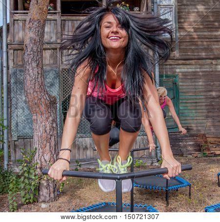 Otwock Poland - Septemberr 25 2016: Fitness women jumping on small trampolines