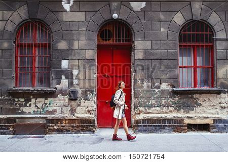 Travel Europe. Young stylish woman on the Background of European City Street and one of the historical architectural buildings of Budapest Hungary. Holidays in European City. Art Lifestyle and Travel Concept.