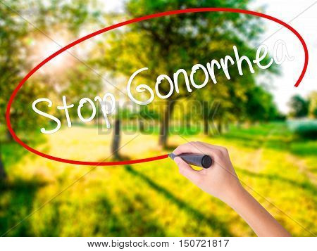 Woman Hand Writing Stop Gonorrhea With A Marker Over Transparent Board .