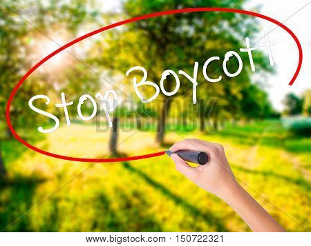 Woman Hand Writing  Stop Boycott With A Marker Over Transparent Board