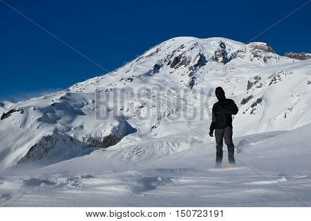 Climber Endures High Wind and Cold at Panorama Point.  Mt Rainier National Park, Washington