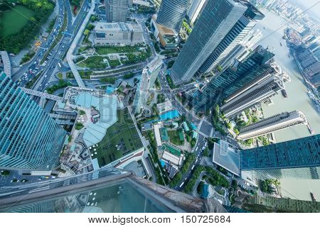 SHANGHAI - AUG 13, 2015: Above view of skyscrapers and river quay, view from IFC hotel, 990 skyscrapers are in Shanghai