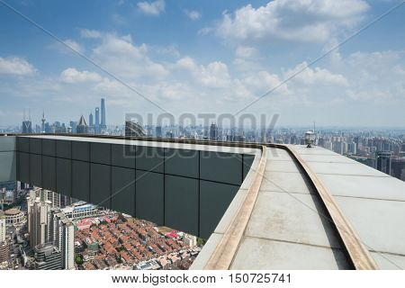 SHANGHAI - AUG 13, 2015: Roof of Plaza 66 building, Tower One is 288 metres (945 ft) high and was completed in 2001, while Tower 2 is 228 metres (748 ft) high and was completed in 2006