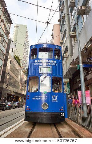 HONG KONG - OCTOBER 25, 2015: double-decker tramway in Hong Kong. Hong Kong is an autonomous territory on the southern coast of China at the Pearl River Estuary and the South China Sea.
