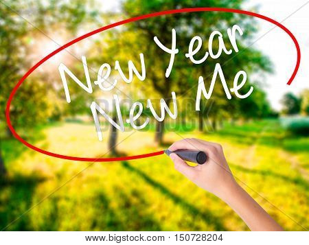 Woman Hand Writing New Year New Me With A Marker Over Transparent Board