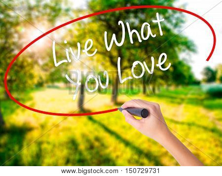 Woman Hand Writing Live What You Love  With A Marker Over Transparent Board