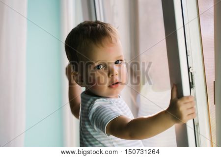 Baby Boy On Window Sill