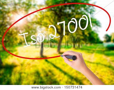 Woman Hand Writing Iso 27001  With A Marker Over Transparent Board