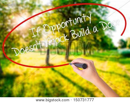 Woman Hand Writing If Opportunity Doesn't Knock Build A Door With A Marker Over Transparent Board