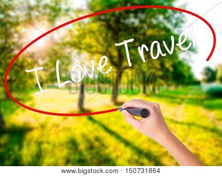 Woman Hand Writing I Love Travel With A Marker Over Transparent Board