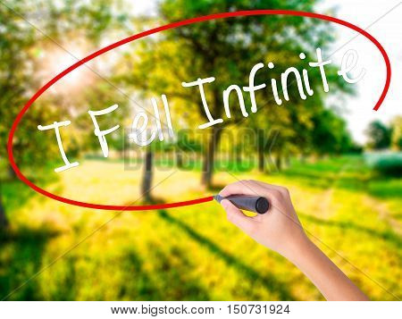 Woman Hand Writing I Fell Infinite With A Marker Over Transparent Board .