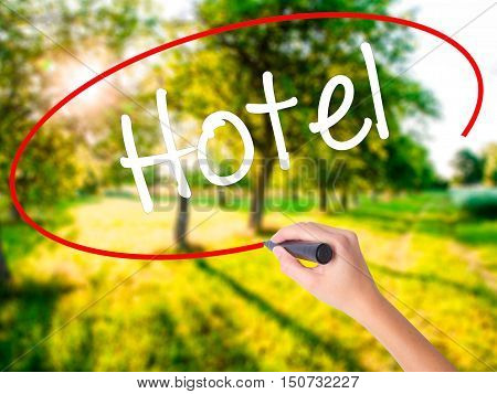 Woman Hand Writing Hotel With A Marker Over Transparent Board
