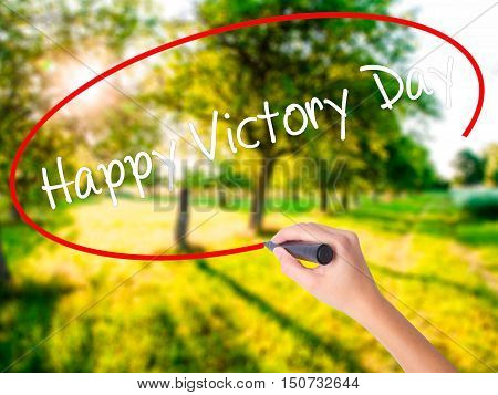 Woman Hand Writing Happy Victory Day With A Marker Over Transparent Board .