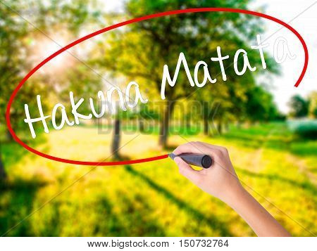 "Woman Hand Writing Hakuna Matata (swahili Phrase; It Means ""no Worries"") With A Marker Ove"