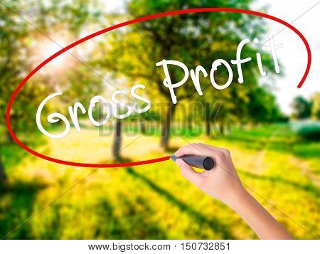 Woman Hand Writing Gross Profit With A Marker Over Transparent Board