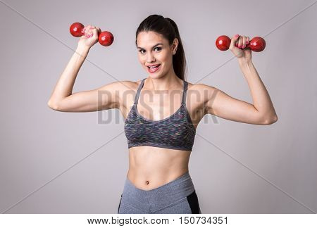 Latina woman exercising with a weight