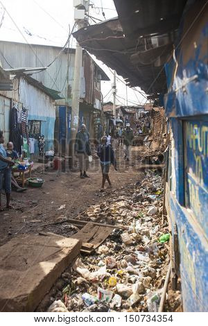 KIBERA, KENYA-NOVEMBER 6, 2015: Unidentified people go about their business in Kibera, Nairobi Kenya's largest slum.