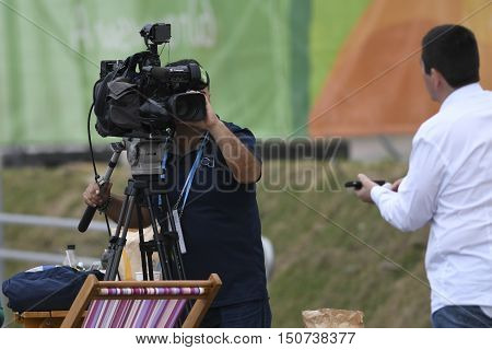 Rio de Janeiro Brazil - august 04 2016: Reporter recording the story uncovered in the village of athletes during the Olympic Games