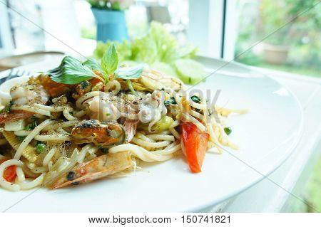 The drunken noodles spaghetti seafood. Thailand style taste