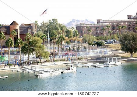 The shores of Lake Havasu with a boardwalk city views and jetties in Lake Havasu City.