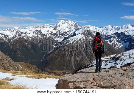 A Woman Hiker Enjoys Stunning Views of Mt Rolleston.  Temple Basin, Arthurs Pass, Southern Alps, New Zealand