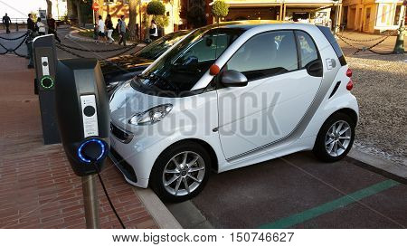 Monaco-Ville Monaco - October 4 2016: Small Smart Fortwo Electric Car at Charging Station in the City Street in Monaco-Ville French Riviera
