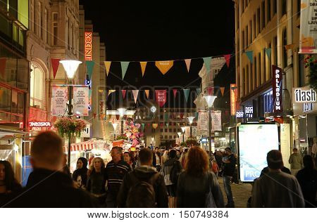 MALMO SWEDEN - AUGUST 16 2016: View of beautiful night scene and people walk on pedestrian street - Sodergatan street in Malmo Sweden on August 16 2016.