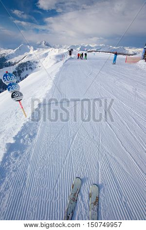KITZBUEHEL AUSTRIA - February 17 2016 - Skiers skiing in Kitzbuehel ski resort and enjoying Alps view from the top of Hahnenkamm place of famous hahnenkamm races. Kitzbuehel ski resort is one of the best ski resort in the world with 54 cable cars and 170