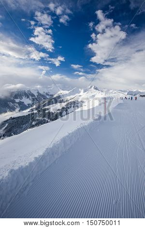 Skiers Skiing In Kitzbuehel Ski Resort And Enjoying Alps View From The Top Of Hahnenkamm, Place Of F