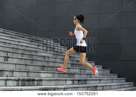 fitness sport woman running upstairs on city stairs