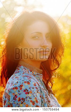 A beautiful young girl on nature portrait