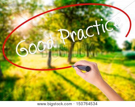Woman Hand Writing Good Practice With A Marker Over Transparent Board .
