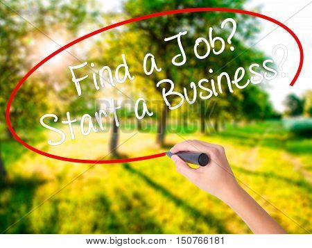 Woman Hand Writing Find A Job? Start A Business?  With A Marker Over Transparent Board