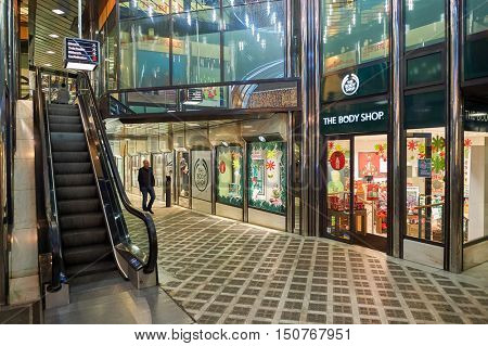 GENEVA, SWITZERLAND - NOVEMBER 18, 2015: The Body Shop store at night. The Body Shop International plc, trading as The Body Shop, is a British cosmetics and skin care company owned by L'Oreal.