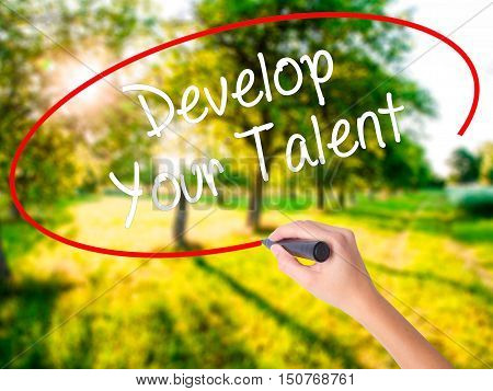 Woman Hand Writing Develop Your Talent With A Marker Over Transparent Board .