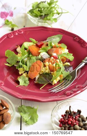 Moroccan salad: carrots millet herbs pepper, vertical