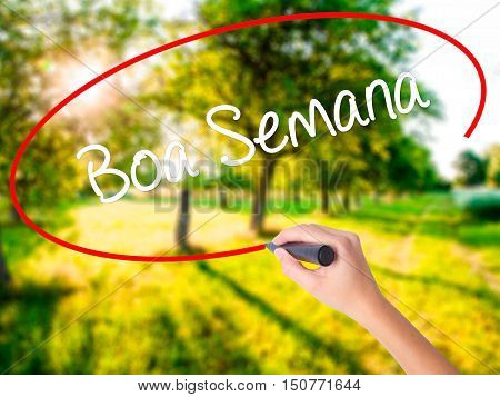 Woman Hand Writing Boa Semana   (good Weekin Portuguese)with A Marker Over Transparent Board