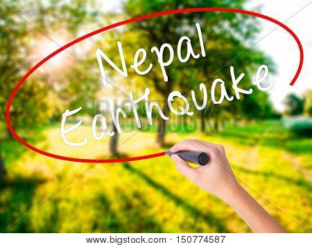 Woman Hand Writing Nepal Earthquake With A Marker Over Transparent Board